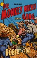 Aufschrift mit TITEL the monkeys wrench gang. dort fährt ein zug lang und 4 personen sitzten mit zündung für etwas daneben